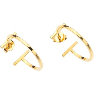 """PAIR OF EARRINGS IN 18K YELLOW GOLD, TIFFANY & CO., TIFFANY T COLLECTION Weight: 4.9 g. Size: 0.39 x 0.9"""" (1.0 x 2.3 cm)"""