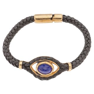"""LEATHER BRACELET WITH LAZURITE AND 18K YELLOW GOLD, TANE 1 Lazurite cabochon. Weight: 22.0 g. Length: 7.2"""" (18.5 cm)"""