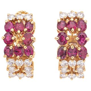 PAIR OF EARRINGS WITH RUBIES AND DIAMONDS IN 18K YELLOW GOLD 16 Oval cut rubies ~1.60 ct and 22 Brilliant cut diamonds ~0.88 ct