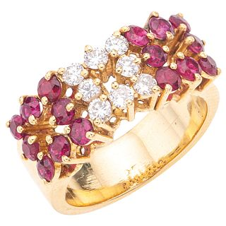RING WITH RUBIES AND DIAMONDS IN 18K YELLOW GOLD 16 Round cut rubies~1.10ct and 8 Brilliant cut diamonds ~0.40 ct. Size:6