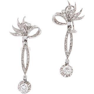 PAIR OF EARRINGS WITH DIAMONDS IN PALLADIUM SILVER 2 Brilliant cut diamonds ~1.0 ct Clarity: I1-I3 and 62 8x8 cut diamonds ~0.30 ct