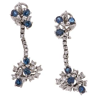 PAIR OF EARRINGS WITH SAPPHIRES AND DIAMONDS IN PALLADIUM SILVER 12 Pear cut sapphires ~2.64 ct and 46 8x8 cut diamonds ~0.80 ct