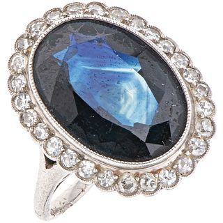 RING WITH SAPPHIRE AND DIAMONDS IN PLATINUM 1 Oval cut sapphire~8.0ct and 28 Diamonds (different cuts)~0.60ct. Weight: 7.3 g. Size:6½
