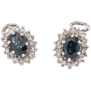 PAIR OF EARRINGS WITH SAPPHIRES AND DIAMONDS IN PALLADIUM SILVER 2 Oval cut sapphires ~1.50 ct and 32 8x8 cut diamonds ~0.48 ct. Weight: 5.2 g