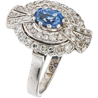 RING WITH SAPPHIRES AND DIAMONDS IN 14K WHITE GOLD 1 Oval cut sapphire ~0.75 ct and 44 8x8 cut diamonds~0.68 ct. Size: 7 ¼