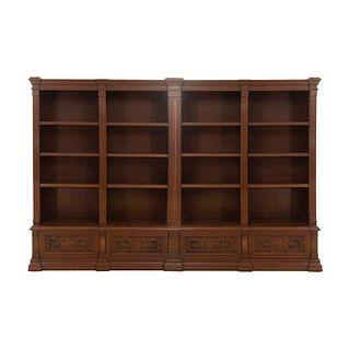 Librero. SXX. Elaborado en madera tallada y enchapada. A 4 cuerpos. Con 2 cajones y entrepaños. 215 x 330 x 40 cm