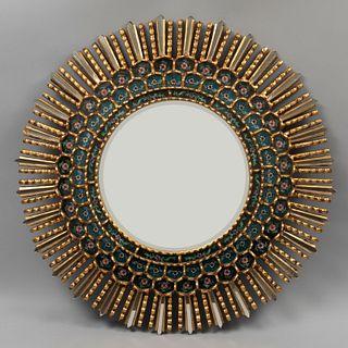 Espejo. SXX. Elaborado en madera dorada. Con luna circular. Decorado con resplandor, teselas florales y de espejo. 74 cm diámetro