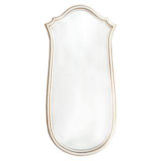 Espejo. SXX. Diseño irregular. Elaborado en talla de madera color blanco. Con luna irregular biselada. 137 x 68 cm