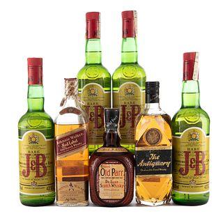 Whisky. a) Johnnie Walker. b) J & B. c) Grand Old Parr. d) The  Antiquary. Total de piezas: 7.