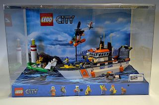 Lego Shop Display featuring Lego City No 60014 Coast Guard Set all house in a plastic display case w