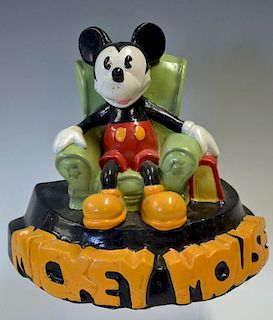Mickey Mouse plaster cast figure featuring Mickey Mouse sitting in a arm chair with bold lettering t