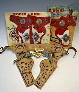 Group of Western related toys to include two carded Rodeo King holster sets, one having a single the