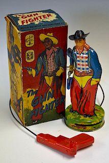Wells Brimtoy (UK) Tinplate Gun Fighter and other Tinplate Toys - scarce 1950s tinplate Cowboy Figur