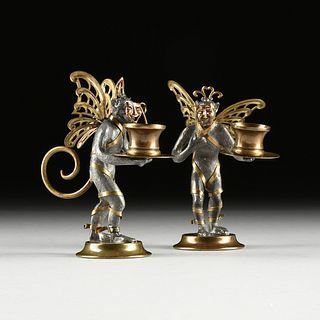 A PAIR OF MARDI GRAS/CARNIVAL THEATRICAL BRASS AND LEAD MONKEY CANDLE STANDS, MODERN,