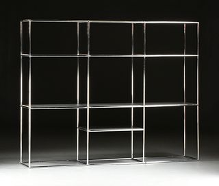 A CONTEMPORARY THREE SECTION CHROMED STEEL BOOK DISPLAY SHELVING UNIT, BY ABSTRACTA,