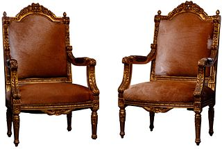 Cowhide and Gilt Wood Arm Chairs