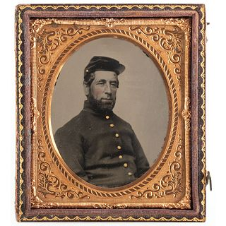 [CIVIL WAR]. Sixth plate ruby ambrotype of 4th Rhode Island soldier and accompanying badge.