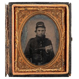 [CIVIL WAR]. Ninth plate ambrotype of soldier posed with knife. N.p.: n.p., [1860s].