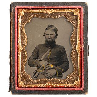 [CIVIL WAR]. Ninth plate tintype of Union cavalryman with sword. N.p., n.d.