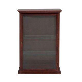 Vitrina. SXX. En talla de madera. Electrificada para una luz. Con puerta abatible con cristal biselado y tirador. 93 x 67 x 17 cm