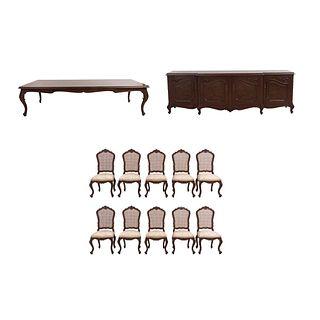 Comedor. SXX. Elaborado en madera tallada y enchapada. Consta de: mesa, 10 sillas y trinchador. 78 x 320 x 125 cm (mayor) Piezas: 12