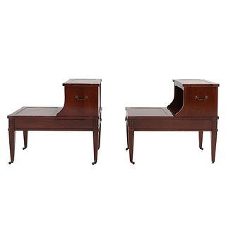 Par de mesas para teléfono. SXX. En talla de madera. Con cubiertas rectangulares, vanos centrales y cajones. 64 x 70 x 47 cm