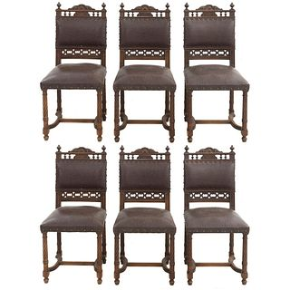 Lote de 6 sillas. Francia. Siglo XX. Estilo Enrique II. En talla de madera de nogal. Con respaldos semiabiertos y asientos.