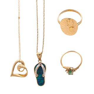 A Collection of Rings & Necklaces in Gold