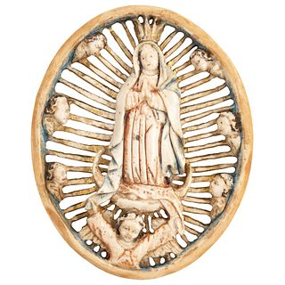 """VIRGIN OF GUADALUPE MEXICO, Ca. 1900. Made of carved and inked ivory. Conservation details. 2.9 x 2.7"""" (7.5 x 7 cm)"""