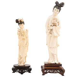 """PAIR OF LADIES CHINA, EARLY 20TH CENTURY Ivory carving with ink details. Lady 1: 9.8"""" (25 cm) in height, Lady 2: 7.4"""" (19 cm) in height"""