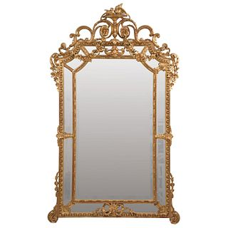 """MIRROR FRANCE, 19TH CENTURY Made of gilded wood with a beveled moon. Decorated with acanthus scrolls. 70.8 x 43.3"""" (180 x 110 cm)"""