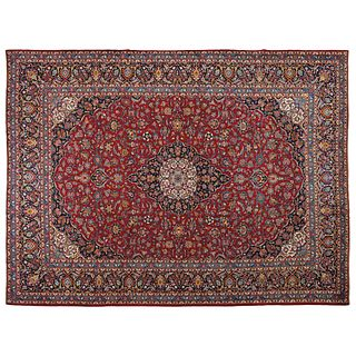 """PERSIAN KASHAN KASHAN, IRAN. Ca. 1960. Finely knotted by hand with natural dyes, in red, blue and beige. 159.8 x 118.1"""" (406 x 300 cm)"""