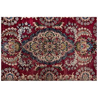 """PERSIAN KERMAN Ca. 1900 Handmade in pile of wool on a cotton base with natural dyes. 70.8 x 51.1"""" (180 x 130 cm)"""
