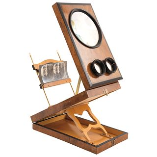 """STEREOSCOPE FRANCE, 19TH CENTURY Made in carved wood. Includes 34 slides. Size: 13.9 x 8.4 x 3.5"""" (35.5 x 21.5 x 9 cm)"""
