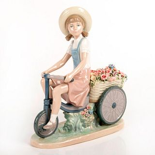 Girl with Flowers in Tow 01005031 - Lladro Porcelain Figurine
