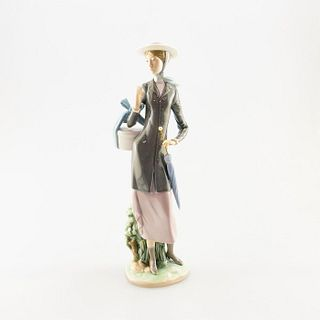 A New Hat 1005345 - Lladro Porcelain Figure