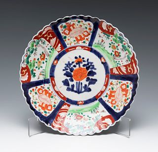Imari style plate. Japan, middle of the 20th century. Glazed porcelain.
