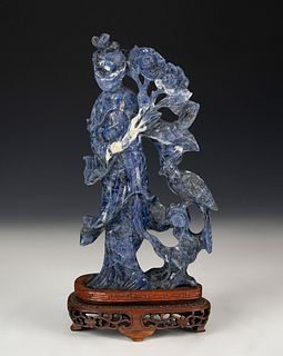 Fairy figure. China, 20th century. Lapis lazuli carved by hand on a wooden base.