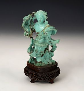 Fairy figure with basket. China, 20th century. Turquoise carved by hand on wooden base.