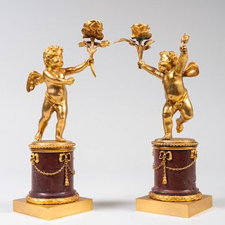 Pair of Continental Gilt-Bronze and Marble Putti Candlesticks