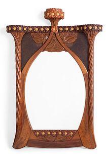 JOAN BUSQUETS I JANÉ (Barcelona, 1874 - 1949). Modernist mirror, ca.1900. Mahogany and walnut wood.