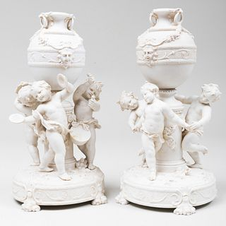Pair of Continental Biscuit Figural Urns