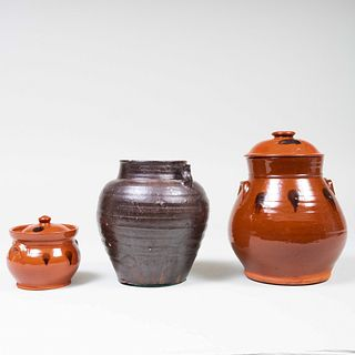 Two American Redware Cannister and Covers and an Earthenware Vessel