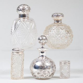 Group of Five Silver-Mounted Cut Glass Toilette Bottles