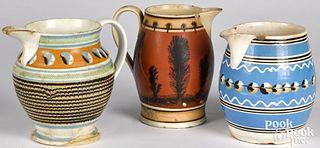 Three mocha pitchers