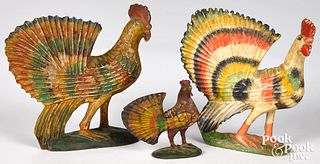Three carved and painted roosters, late 19th c.