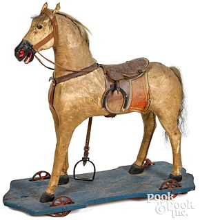 Large hide covered horse pull toy, late 19th c., 2