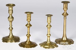 Four Queen Anne scalloped base candlesticks, mid 1