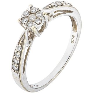 RING WITH DIAMONDS IN 14K WHITE GOLD Brilliant cut diamonds ~0.22 ct. Weight: 2.5 g. Size: 7
