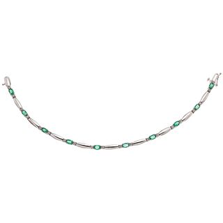BRACELET WITH EMERALDS AND DIAMONDS IN 14K WHITE GOLD Oval cut emeralds ~1.0 ct 8x8 cut diamonds ~0.10 ct